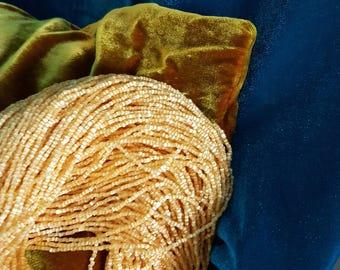 Strand of seed beads strung vintage satin #10 honey Czech glass