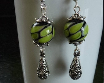 Pearl Green/Black Lampwork earrings and drops carved mounted on a silver hook Tibetan silver charms