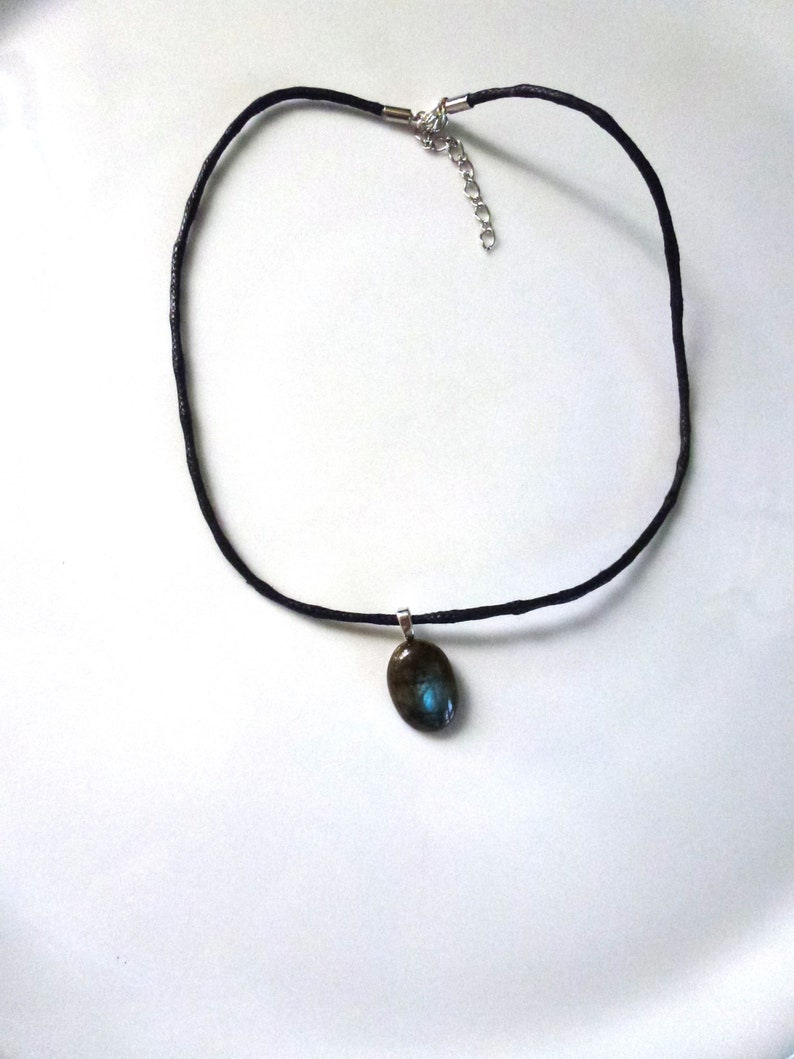 oval cabochon in real blue Labradorite mounted in pendant on black waxed cotton cord musket closure and extension chain