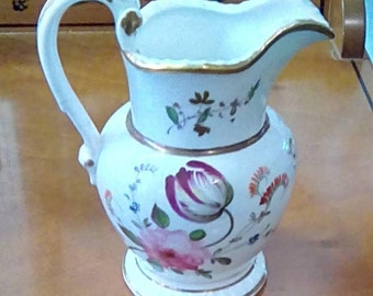 Early 19th Century porcelain betrothal jug with gilded initials and dated to 1829. Unmarked but possibly Coalport.
