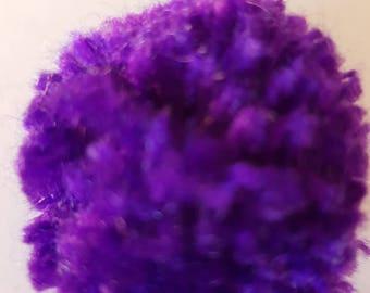 A simple purple Pom Pom brooch
