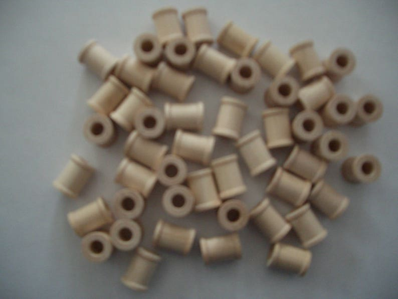 58 0.7 cm 1.5 cm 1.3 cm high Each is 12 hole in diam. with a 14 25 Unfinished Wood SPOOLS for Crafts and Toy or Game parts
