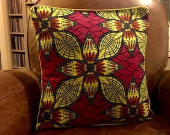 Cushion cover in yellow, Burgundy and orange wax