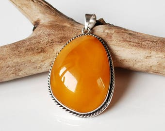 Baltic amber pendant etsy natural vintage baltic amber pendant butterscotch amber pendant huge amber and sterling silver pendant antique amber piece amber jewelry aloadofball Images