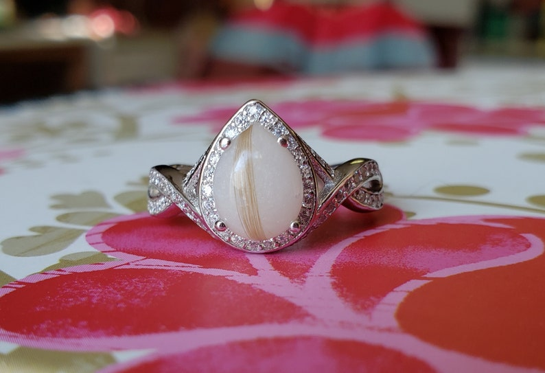 Sterling Silver Teardrop Infinity Breastmilk Ring with simulated diamonds