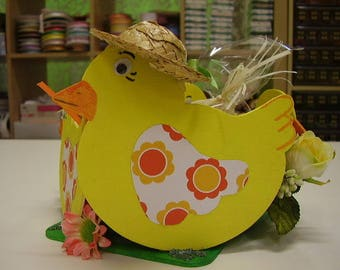 Wooden Easter basket with chocolate eggs