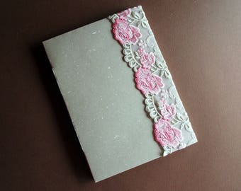 Handmade longstitched-bound notebook with lace