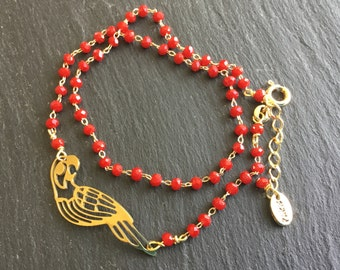 Gold plated red bracelet with parrot