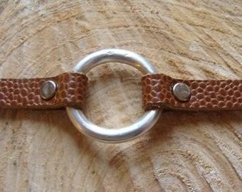 Contemporary leather bracelet and circle motif in sterling silver