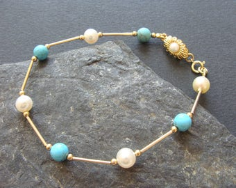 Brass bracelet, cultured pearls, turquoise beads