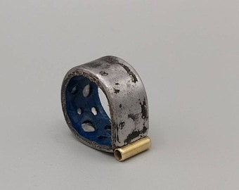 Steel ring, brass, blue tinted leather