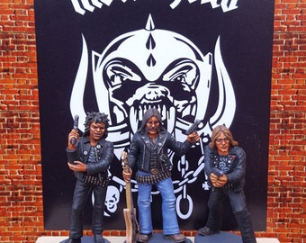 Motörhead figurines Lemmy , Philthy Animal Phil Taylor , Fadt Eddy Clarke .