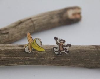 Mismatched earrings banana and monkey