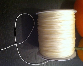 2 meters of 0.8 mm diameter white colored nylon thread