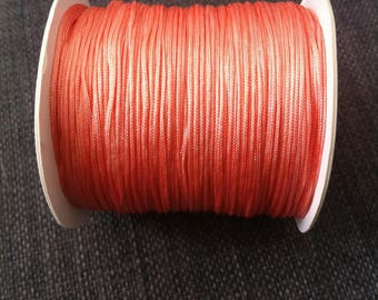 2 meters of 0.8 mm diameter coral colored nylon thread