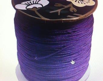 2 meters of 0.8 mm diameter purple colored nylon thread