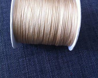 2 meters of 0.8 mm diameter ivory colored nylon thread