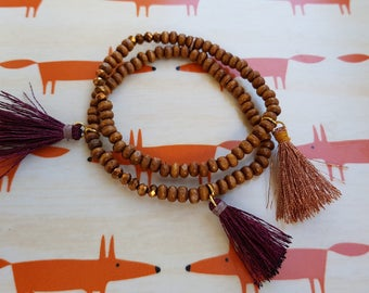 2 stretch bracelets - wooden beads and tassels - handmade