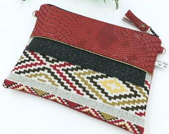 //TOINETTE fringe clutch / / red stripes pattern