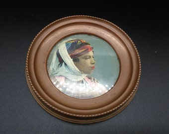 round frame with portrait of a vintage woman