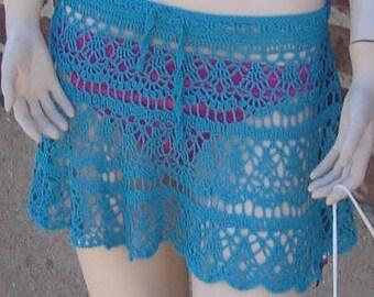 Fluid short skirt of turquoise blue beach(range) in the hook