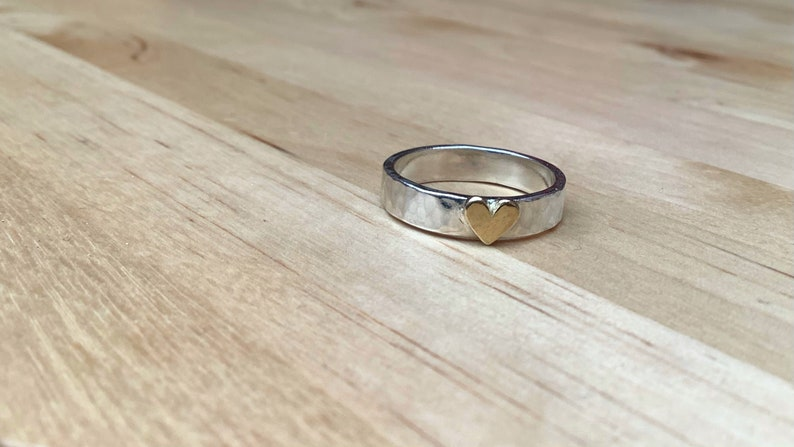 solid silver Sterling silver hammered finish ring with small brass heart hand made in the UK optional personalised engraving