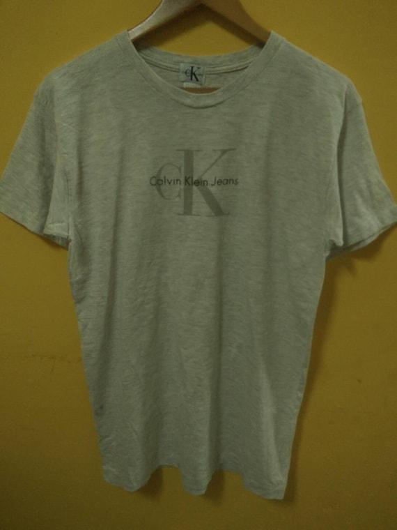 61ebf34a79ba Mega SaleVintage Calvin Klein T-Shirt | Etsy