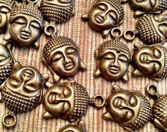 a bronze Buddha pendant