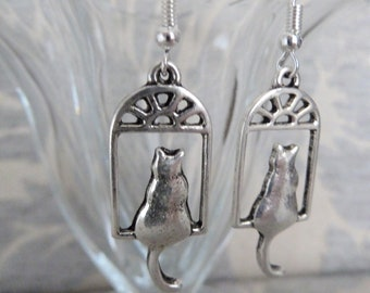 handmade silver plated cat at a window charm earrings, uk jewellery