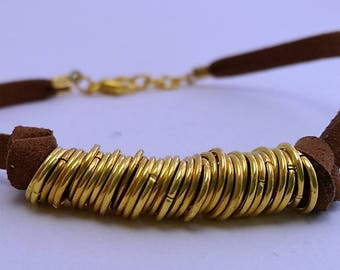 Leather bracelet and golden rings
