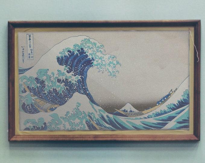 Kanazawa Oki Nami Ura by Katsushika Hokusai - 1760-1849 - Japanese Ukyio-e style illustration of extreme waves bearing down on the boats