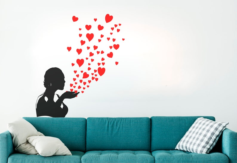 SVG  Girl Blowing Hearts // Universally Compatible Cut Files image 0