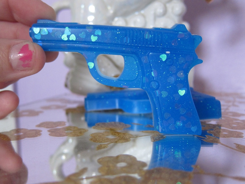3aceae99f Blue Holographic Sparkle Magic Epoxy Resin Gun Brooch Pistol Pin Kawaii  Candy Jewelry UV Reactive