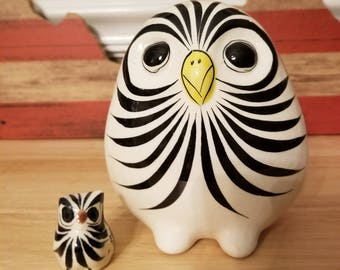 White ceramic painted spotted owl and his little friend. Mexico.