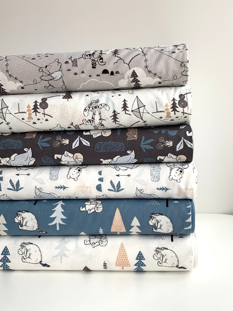 woven fabric Camelot fabrics apparel fabric Disney fabric Winnie the Pooh and blanket on dark grey cotton fabric quilting fabric