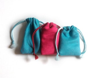 set of 3 small cases in pink suede and turquoise