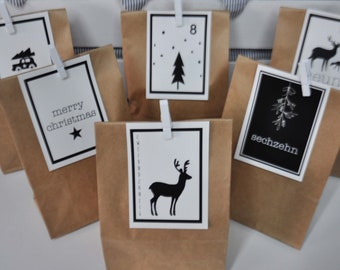 Advent calendar made of paper. The advent calendar consists of 24 paper bags with matching cards 1-24 and white brackets