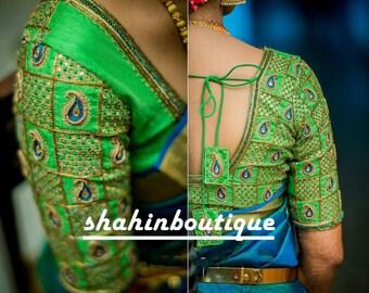 14bec7327e2a85 Attractive White blouse with gold floral threadwork silk saree