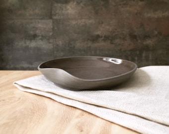 Handmade ceramic plate, shallow bowl from black / dark grey stoneware clay, simple and elegant design.