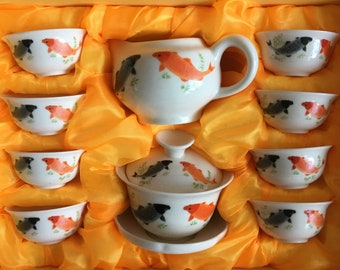 Beautiful Chinese / Japanese tea set with drawing Koi fish from porcelain,
