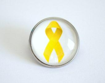 Brooch, round, yellow ribbon, endometriosis support