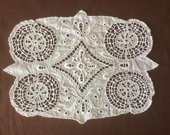 Doily. Antique linen tablecloth or application with Richelieu embroidery technique. Vintage doily Napperon ancien
