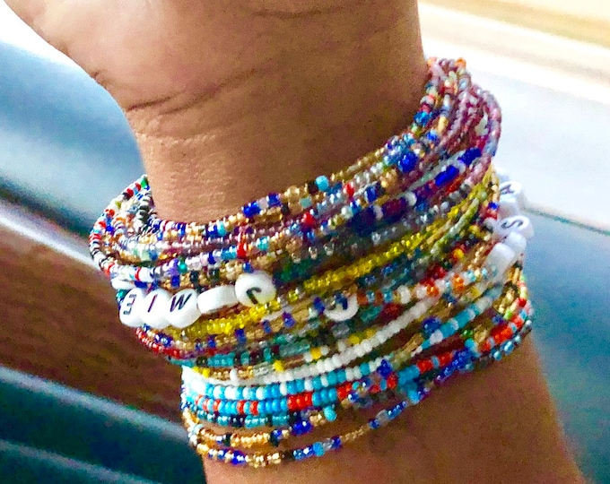 Featured listing image: Roll On Non-Stretch Set of 10 Seed Beads Bracelet Set, African Colors Inspired Bracelets, Maasai Bracelets