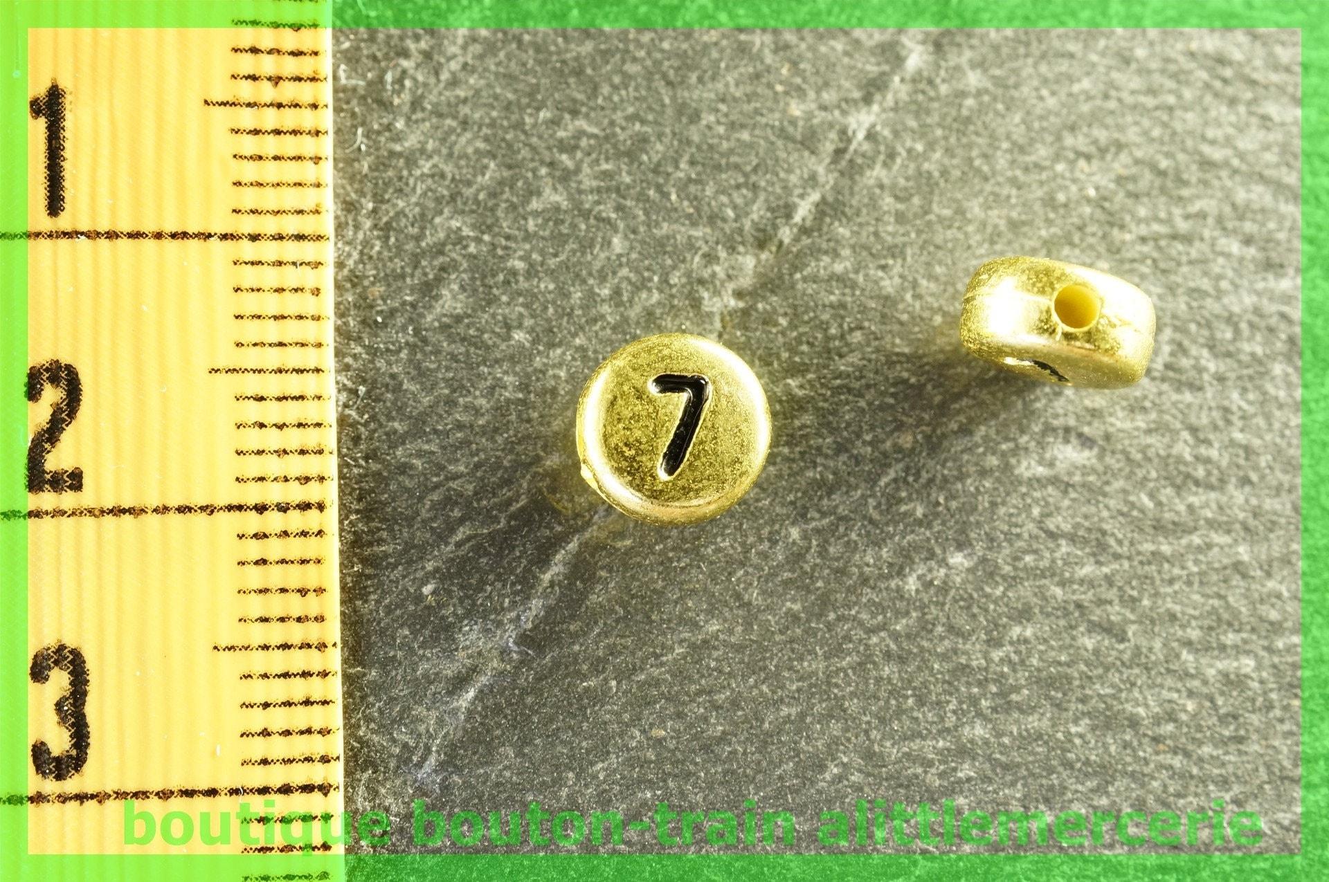 perle ronde chiffre chiffre chiffre 7 plastique doré et noir 1372b7
