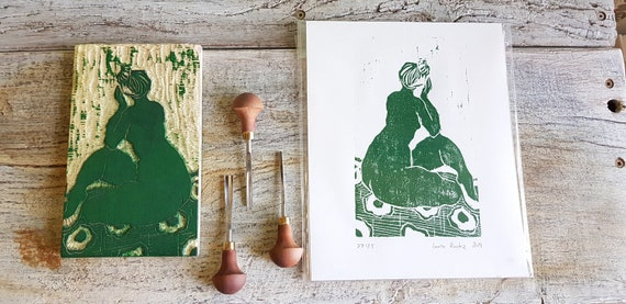 Wood engraving, depicting a nude Assi of back with green ink. Artisanal printing of a drawing engraved on wood.