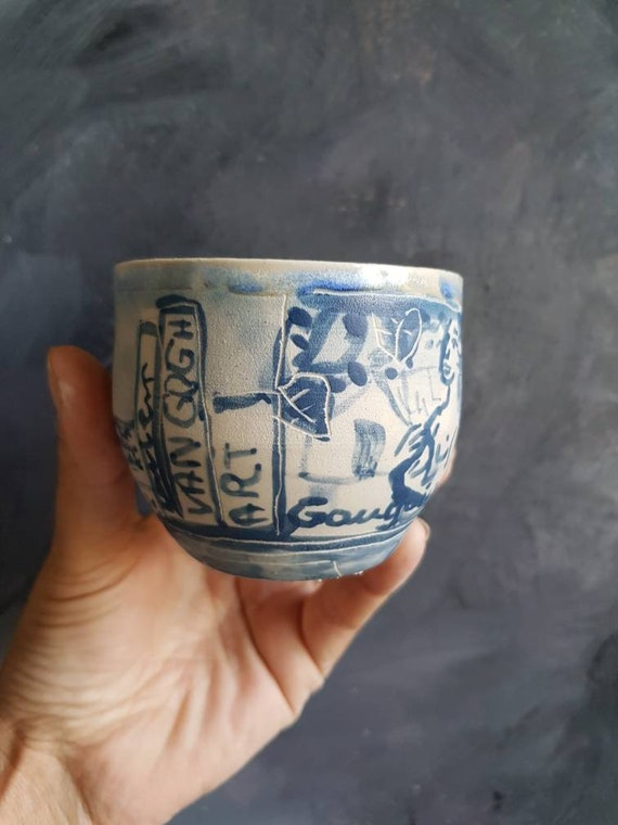 Blue and white artisan coffee cup. Pottery cup with drawing. Art Gaugin, Van Gogh.