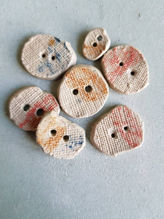 Handmade, bi material beige and Tan pottery round button. Handmade set of 7 buttons.