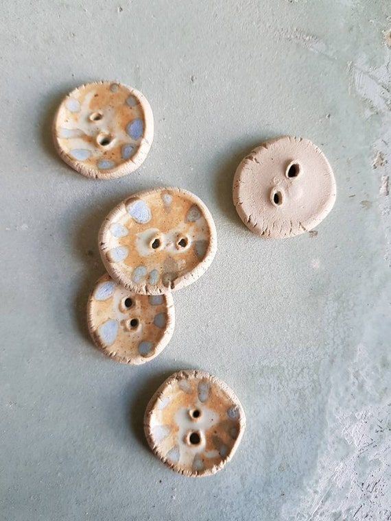 Pottery round button made by hand, bi material beige and blue polka dot on bottom of ocher glaze. Set of 5 buttons.