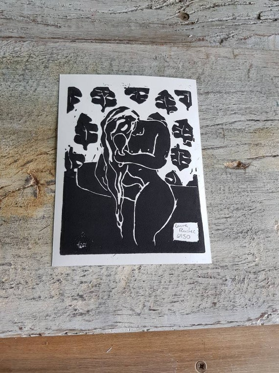 Linogravure, representing a nude this hairdresser with black ink . Handcrafted print numbered and signed.