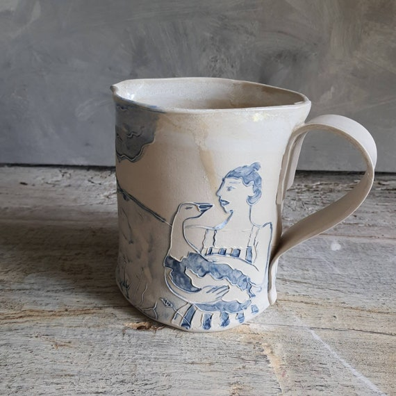 Pitcher pitcher in handmade pottery with handle water pot blue and white drawing woman